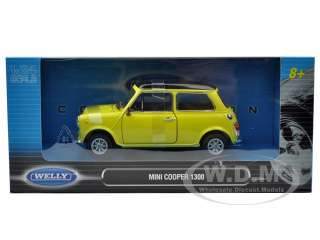 model of Old Mini Cooper 1300 Yellow diecast car model by Welly